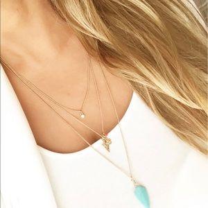 Express gold layered hamsa stone necklace